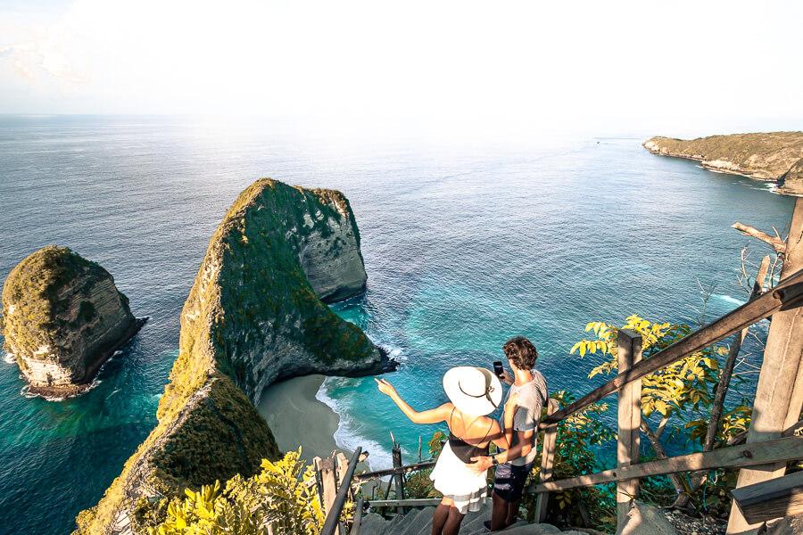Kelingking stairs and Ries watching his phone Nusa Pendia Bali